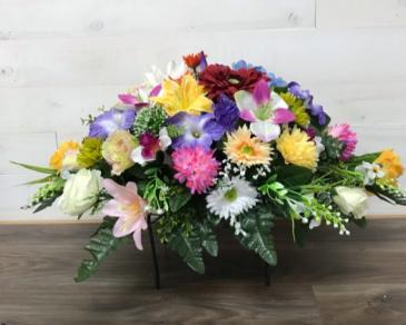 Headstone saddle arrangement Silk flowers