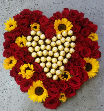 Heart with red roses, sunflowers and chocolates