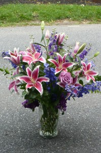 Heavenly Song    Stargazers with Garden Flowers Shown at  $130.00