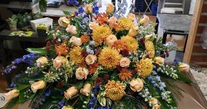 Heaven's Warm Embrace Casket Spray in Port Huron, MI | CHRISTOPHER'S FLOWERS