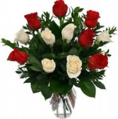 Dozen Red and White Roses arrranged in a vase. We add baby's breath too!