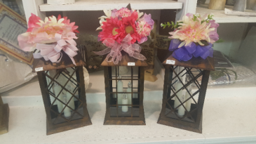 Tin lanterns battery operated (pictures give  Examples of different looks with silks...may vary with seasons)