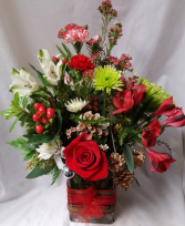 Green and red colors arranged in a cute  rectangular vase with ribbon detail!