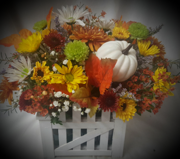 """FALL PICKET FENCE ARRANGEMENT"" cute keepsake wood container filled with fall poms and daisies and pumpkin. Cute table arrangement and after flowers are gone you could put a 4"" plant in this. Has liner."