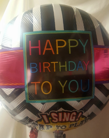 """NEW SINGING BALLOON"" Oversized  Mylar Balloon  that Sings Happy Birthday when you tap it!!! Comes with a weight!! Add to flowers or treats!(We have many to select from...so it may be a different look)"