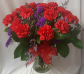 DOZEN RED CARNATIONS WITH PURPLE STATUS ARRANGED in a vase!