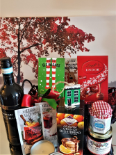 CANDY CANE LANE BASKET Includes a bottle of red wine