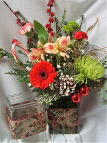 HOLIDAY CHEER! CHRISTMAS RIBBON DETAIL ON  RECTANGULAR VASE FILLED WITH RED, WHITE AND GREEN FLOWERS!!