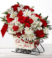 Holiday Treditions Sleigh with flowers Christmas flowers