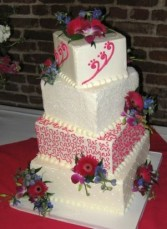 hot pink and turquoise wedding cake
