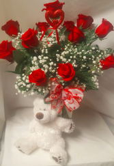'HUGS AND KISSES' DOZEN RED ROSES ARRANGED IN A  vase with baby's breath and a white medium bear!!