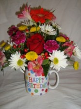 Happy Birthday mug with bright flowers arranged  in it!! Add a Mylar Balloon at checkout!