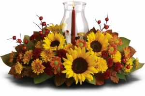 Hurricane and Sunflowers Centerpiece  in Lebanon, NH | LEBANON GARDEN OF EDEN FLORAL SHOP