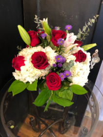 Hydrangeas lilies and roses