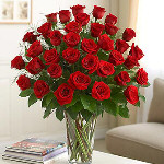 """I LOVE YOU THE MOST"" 3 Dozen long stem red or colored roses arranged in a vase"