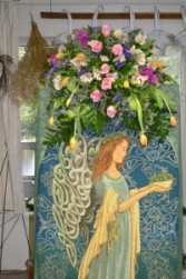Irish Angel Floral Tribute  afghan on easel with accent of fresh floral