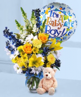 Its A Boy  Vase Arrangement..We Have To Substatute The Yellow Lilies For Another Flower Not Allowed In Hospials