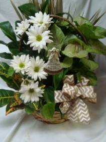 Planter with cut flowers or seasonal silk flowers