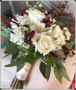 Ivory rose and burgundy bouquet Wedding bouquet in Marion, IA | Roots In Bloom
