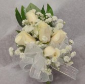corsage with 5 sweetheart roses and baby's breath with cream ribbon or any color ribbon