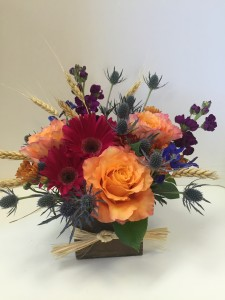Fall Sunset Jewel tones in a wooden box in Northport, NY | HENGSTENBERG'S FLORIST