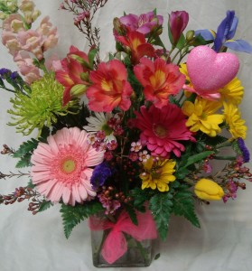 """""""FROM THE HEART"""" Bright Mixed flowers arranged in  vase."""