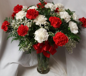 2 dozen carnations arranged in a vase. (colors may vary depending on what is in stock for same day delivery.