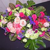 JUBILANT CELEBRATION OF LIFE Casket Flowers
