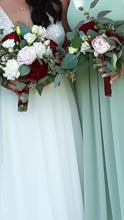 June happiness bride and her attendant bouquet
