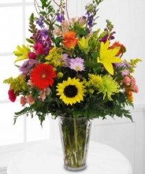 MEMORABLE TRIBUTE Bright Seasonal flowers arranged