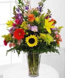 MEMORABLE TRIBUTE Bright Seasonal flowers arranged