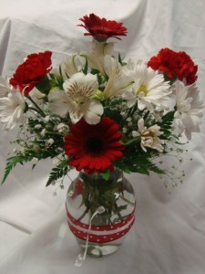 Cute vase with red  and white polka dot ribbon and red and white flowers!!