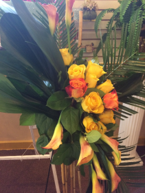 Lady J'S Bamboo Spray Yellow calla lillies/variegated roses with bamboo sticks on stand