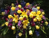 Yellow and Purple Casket Spray