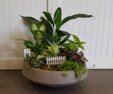 Large cement planter with fence and mini rabbits planter