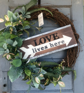 """Large """"Love Lives Here"""" wreath with greenery"""
