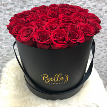LARGE ROUND BOX ROSES THAT LAST A YEAR,