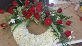 Large Sympathy wreath Lush wreath of white hydranga's Red roses and red Gerbera's