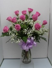 Lavender long stemmed roses Arranged in glass vase