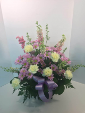 lavender ,pink,and yellow funeral arrangement