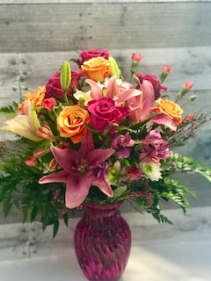 Light My Fire Pink lilies, colorful roses,mini carns, fillers