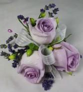 Light purple rose corsage