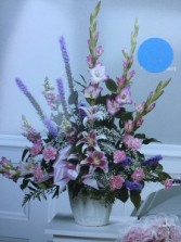 Lilies, glads, carnations, larkspur and gyp Vase arrangement