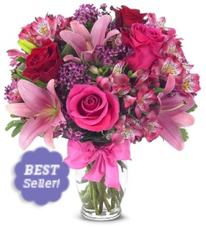 Lilly and roses in Pinks Pink and Red roses with lillies  in Elyria, OH | PUFFER'S FLORAL SHOPPE, INC.