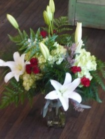 Lily Garden in Glass Vase Shown at $80.00