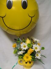 Make someone smile today! Happy face balloon included.