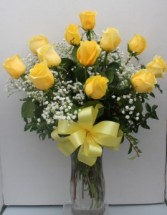 Long stemmed Yellow Roses Arranged in glass vase