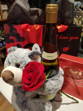 LOVE HUGS & CHEERS! Single rose, bear, wine and box of chocolates