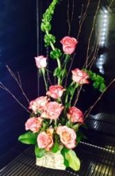 Love is in the iar Dozen roses in an artful design