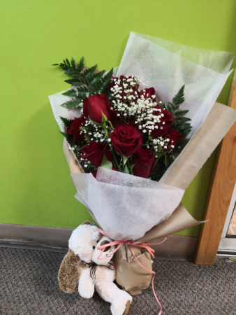 Love me?  One dozen red roses with baby breath wrapped
